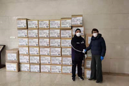 Zhang Jiabo overseeing the shipment of medical masks