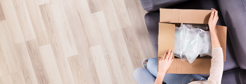 women-are-package-box-on-the-wooden-floor